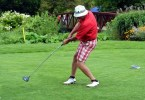 left handed man playing golf
