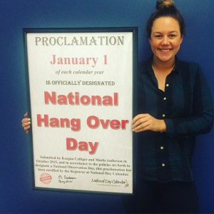 Keegan Calligar holding the Proclamation for National Hangover Day.