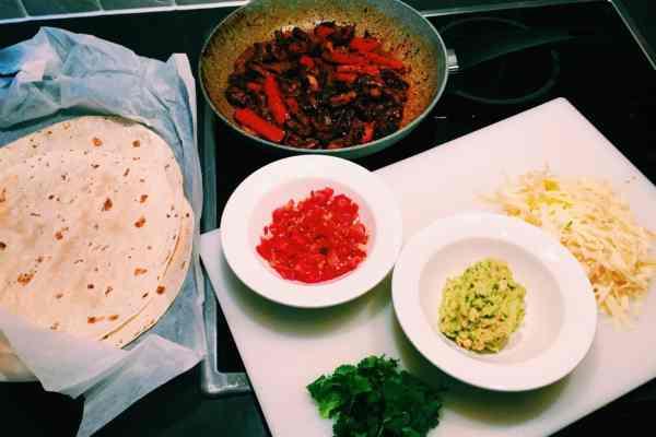 Mexican ribeye fajitas with guacomole tomato salsa cheddar cheese nationaldish