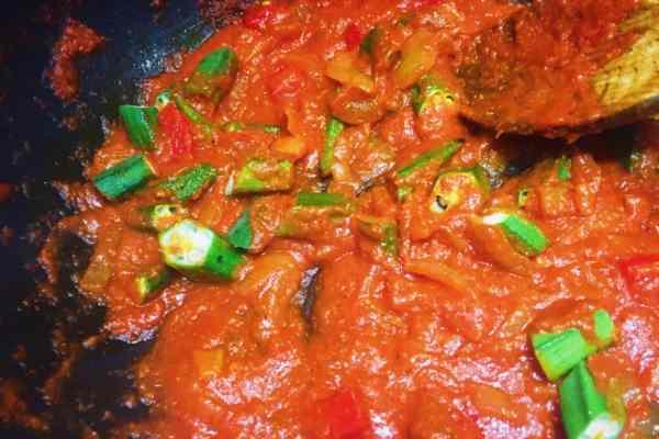 Okra and red pepper added to jollof rice sauce ghana nationaldish