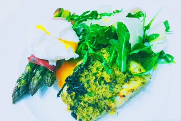 Italian pesto cod with asparagus with Parma ham and poached egg