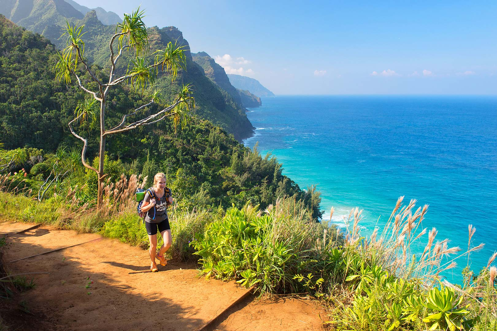 Picture of a woman hiking Kalalau Trail on the Na Pali Coast, Kauai, Hawaii