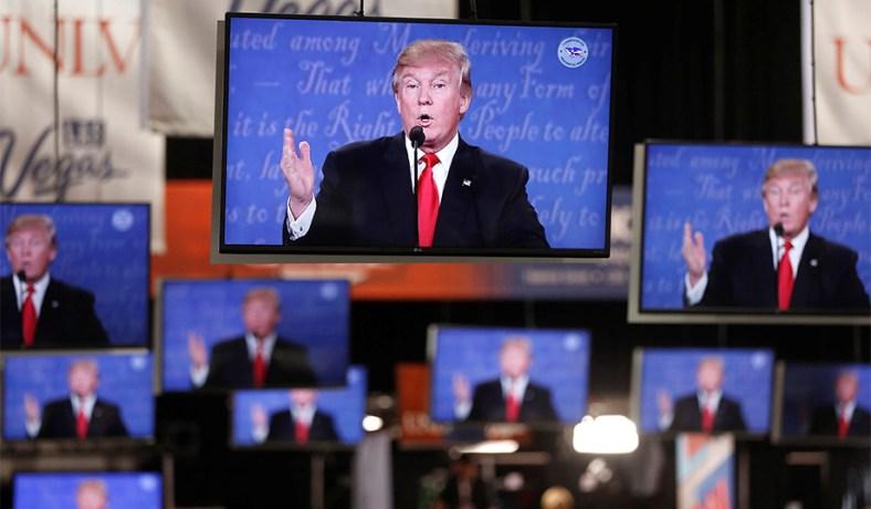 Video monitors in the press room during the final presidential debate,  October 19, 2016. (Reuters photo: Jim Urquhart) ...