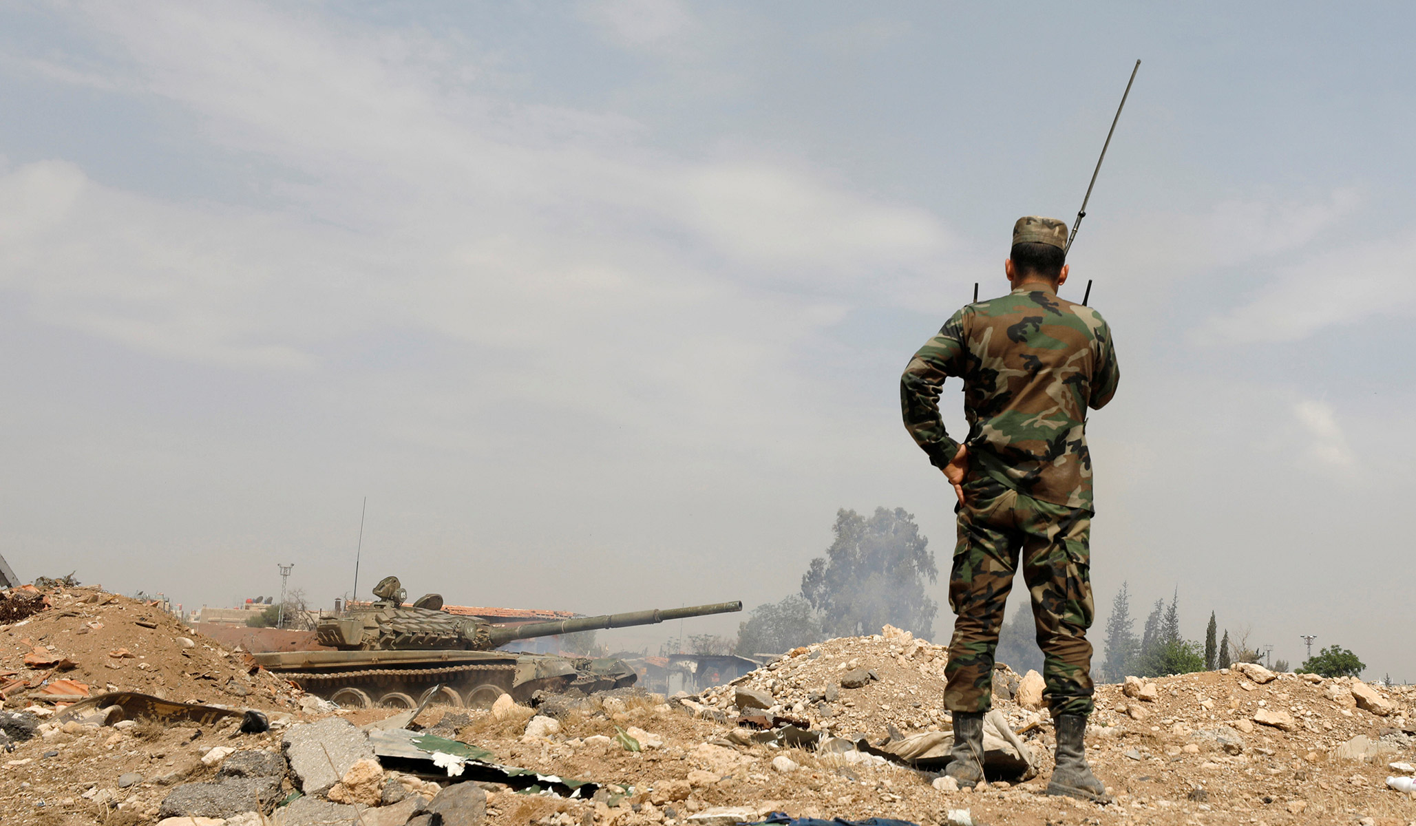 Kurds Ally with Assad's Forces as Turks Advance into Syria