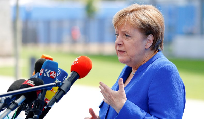 German Chancellor Angela Merkel Talks To The Press As She Arrives At The Alliances Headquarters Ahead Of The Nato Summit In Brussels Belgium July