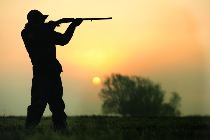 human holding a gun