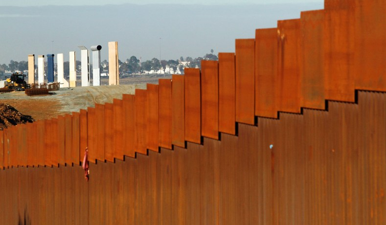 the prototypes for president donald trumps border wall stand behind the border fence between mexico and the united states in tijuana mexico january 7