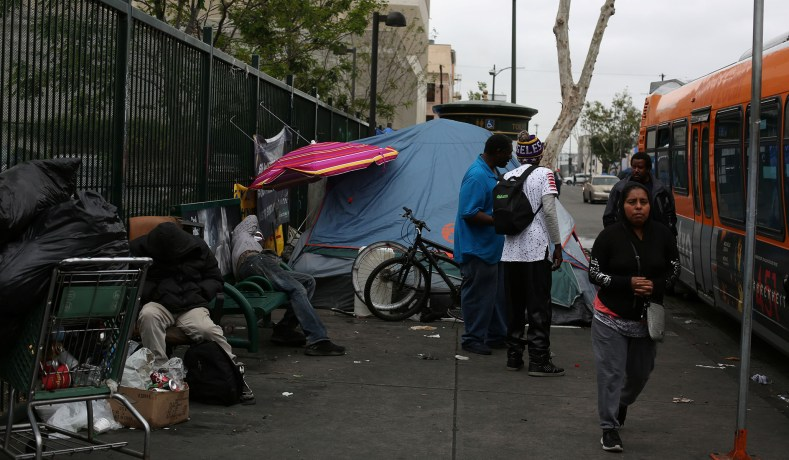 The Inclusive Economy How To Bring Wealth To Americas Poor Book  A Homeless Encampment On A Sidewalk In Los Angeles Calif May    Dania Maxwellreuters  Mental Health Essay also General English Essays  An Essay On Newspaper