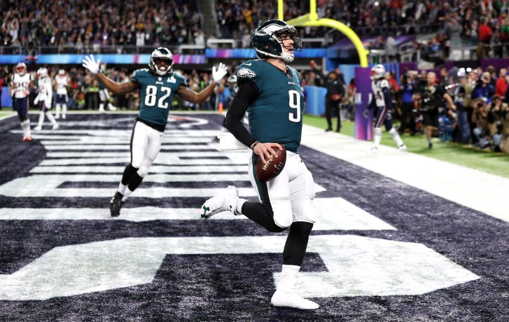 Philadelphia Eagles quarterback Nick Foles scores a touchdown against the  New England Patriots during Super Bowl LII at U.S. Bank Stadium in  Minneapolis 3d079b5cb