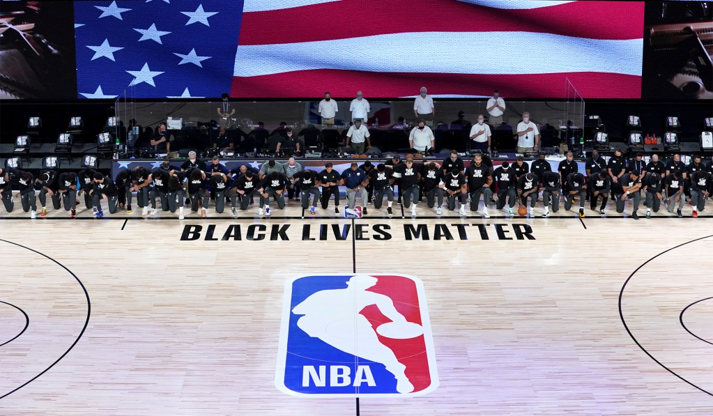 NBA Resumes Season with 'Black Lives Matter' Painted on Court