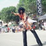 Stilt walker in disco costume - 4ft high platform boots, shiny gold jumpsuit and giant afro