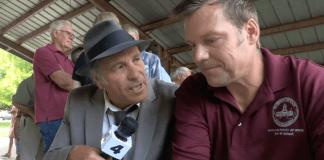 Greg Palast confronts Kris Kobach
