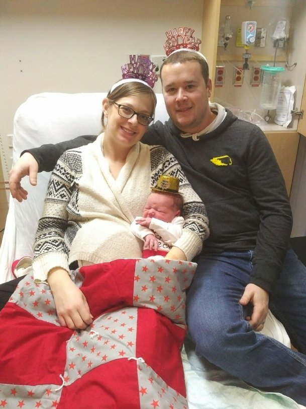 Julie and Daniel Teasdale with son Henry.