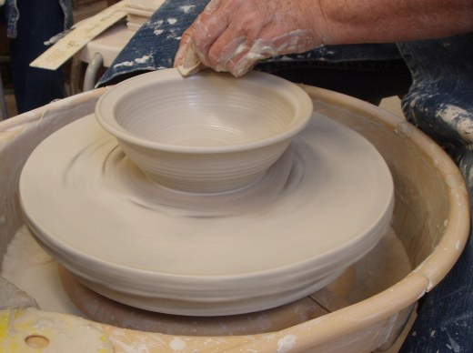 Debbie Gilmer molds a bowl from clay. Below is an example of her handiwork.