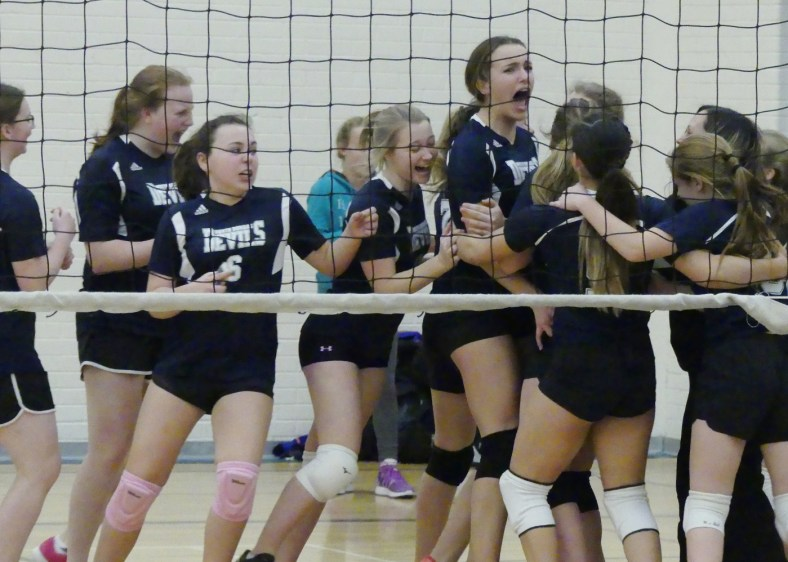 The girls' team celebrates after winning a final set against North Grenville 16-14. Zandbergen photo, Nation Valley News