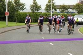 The cyclists on the final stretch towards the finish line at NATS Prestwick Centre