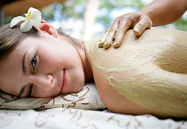 massaging the body scrub