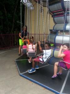 Little man on the kiddie swings