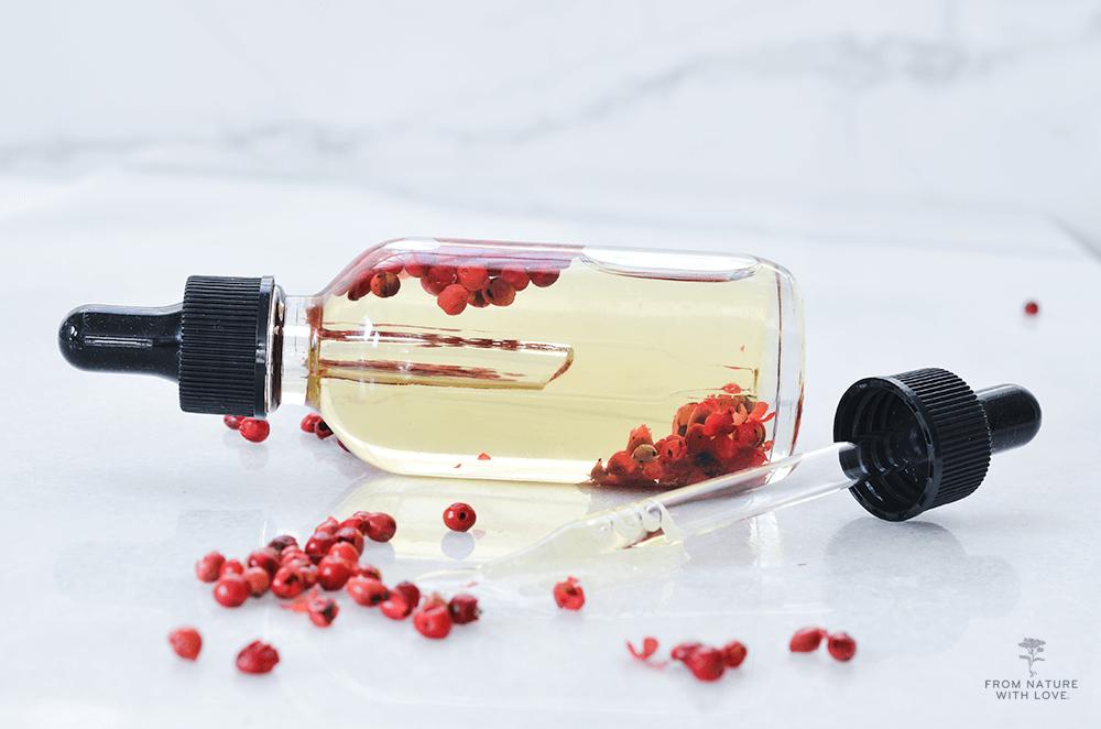 How to Make a Pink Peppercorn & Peruvian Myrtle Massage Oil - a stimulating massage blend made with pink peppercorn, Peruvian myrtle, and Brazil nut oil