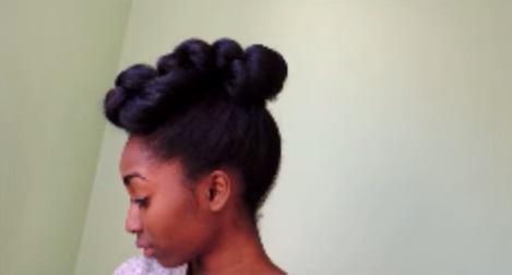 intricate high bun formal hairstyle