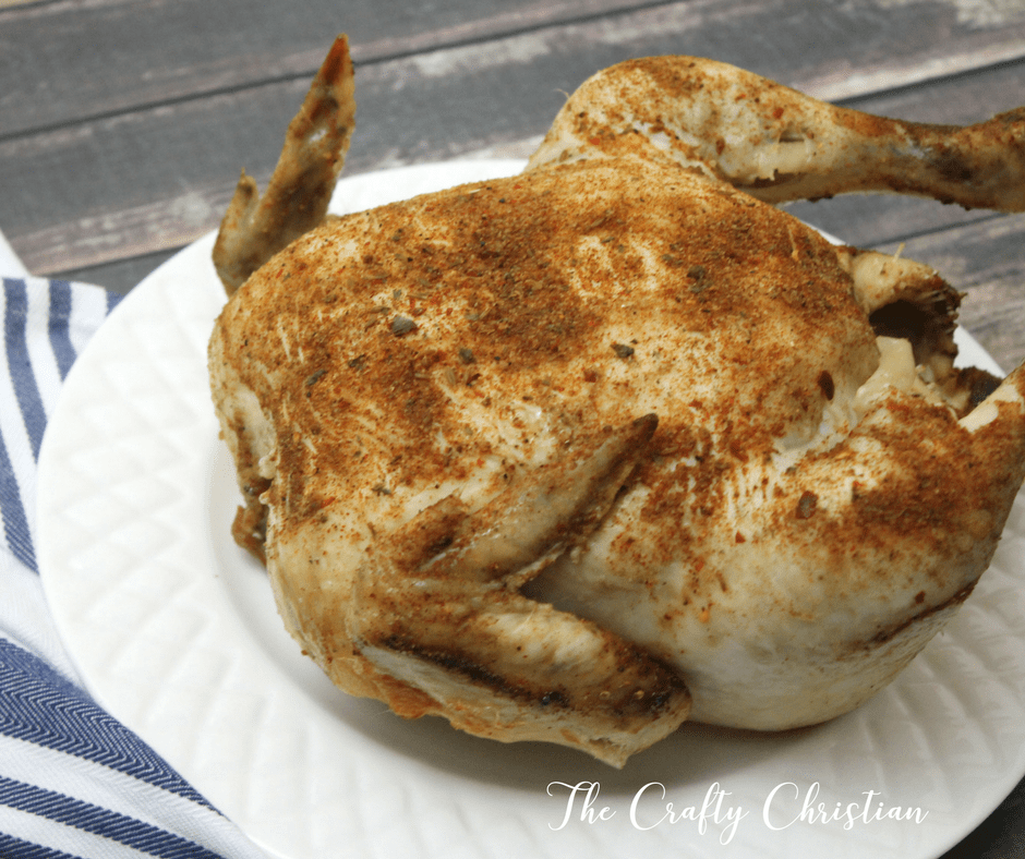 crockpot cooked whole chicken on a plate