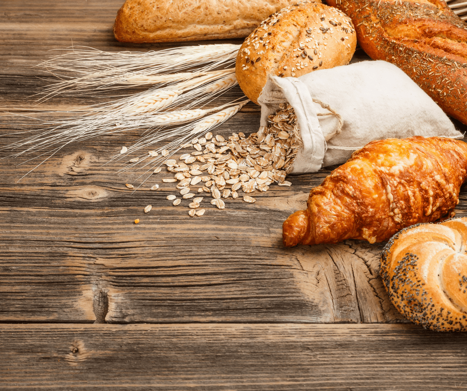 bread, pastries, and a linen bag of oats