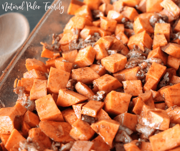 Roasted bacon sweet potatoes in a glass baking dish