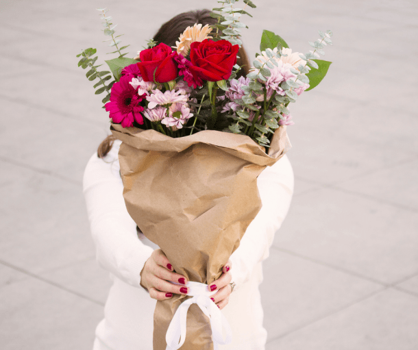Woman holding out a bouquet of flowers