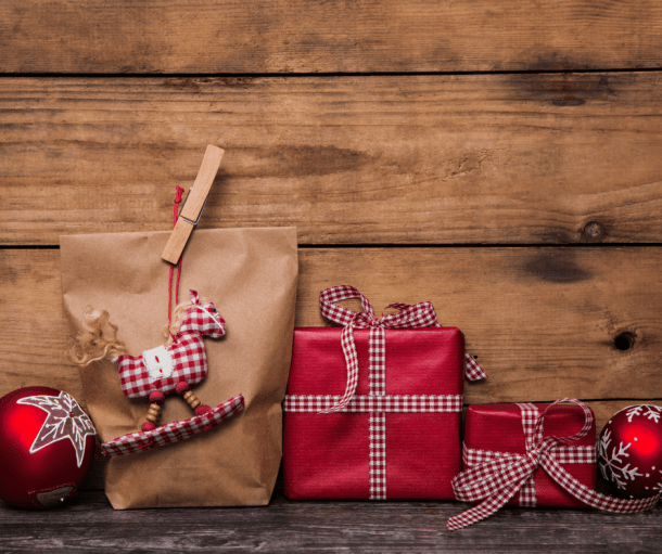 Christmas packages against a wall with wooden slats