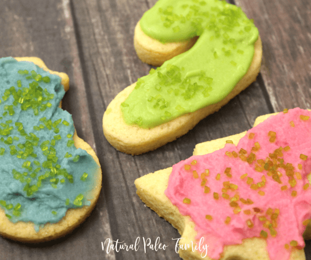 keto frosted christmas cookies on wood table, paleo christmas cookies
