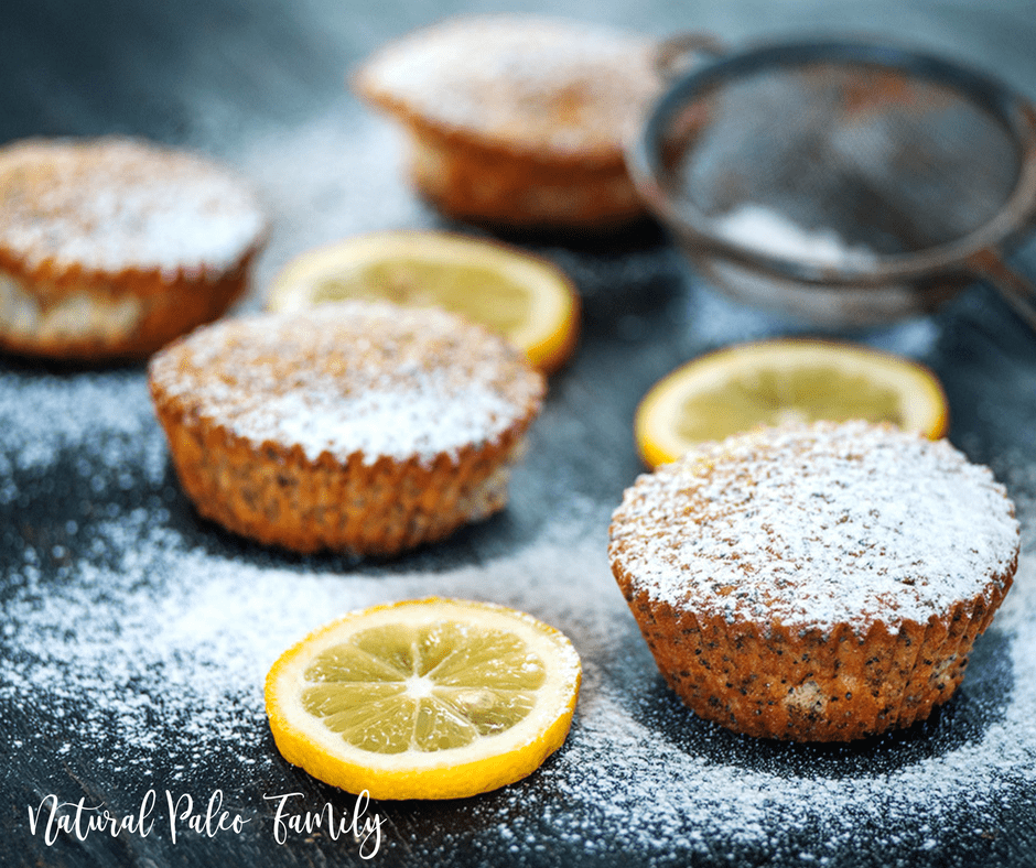 paleo lemon poppyseed muffins with powdered sugar sprinkled on top