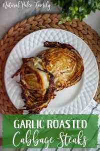 Garlic roasted cabbage on a white plate