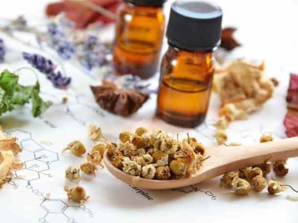 essential oil bottle and dried herbs