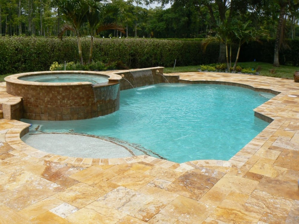 Gold travertine bullnose coping around pool with travertine pavers San Jose