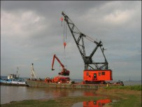 The digger being transported across to the island. RSPB