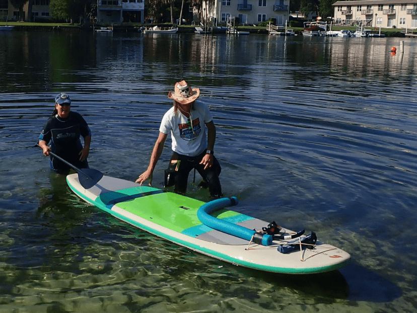 pushing the paddleboard
