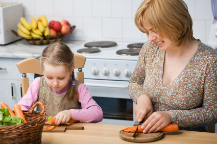 Mother and daughter prepare meal