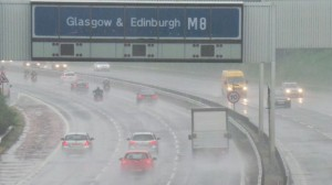 A photograph showing the heavy rain downpour over the M8 Glasgow-Edinburgh road link in July 2013.