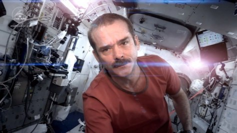 A photograph showing astronaut Chris Hadfield on board the International Space Station (ISS) in the video of his cover version of 'Space Oddity' by David Bowie.