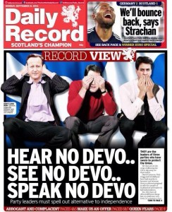 """A photograph showing the front page of the Daily Record. The caption reads: """"Hear No Devo.. See No Devo.. Speak No Devo.."""""""