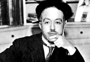 A black and white photograph of Louis de Broglie.