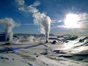 A photograph showing Iceland's first geothermal power station. Large plumes of vapour can be seen rising above the installations.