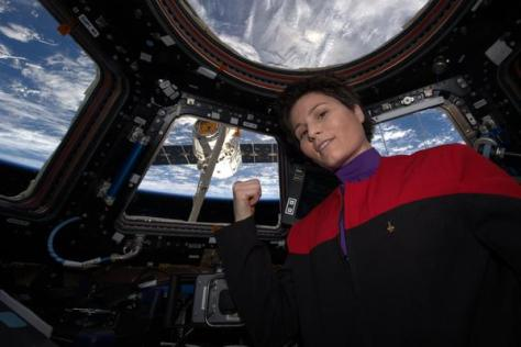 A photograph showing Italian astronaut Samantha Cristoforetti, sporting her Starfleet uniform on board the International Space Station.