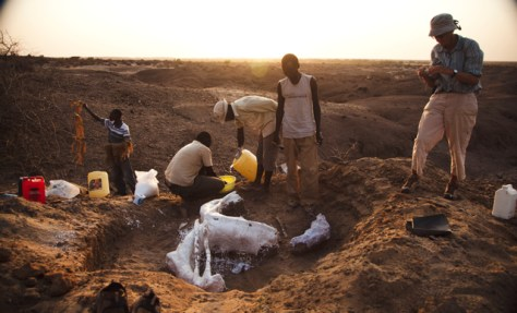 Workers busy documenting a paleontological dig site in a desertic part of the Turkana basin in Kenya where some fossil bones have been found.