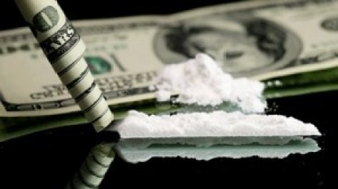 A classic picture showing a line of cocaine, along with a rolled-up dollar bill.