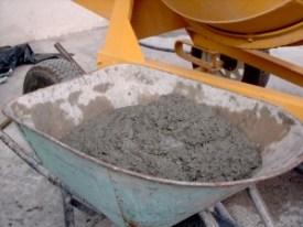 A photograph showing a wheelbarrow full of modern Portland cement.