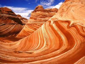 A photograph showing one of the most famous geological features of the Arizona desert, called The Wave.