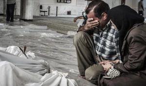 A photograph showing the grief-stricken relatives of the victims of the Eastern Ghouta chemical attack.