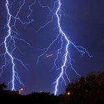 "A photograph showing two lightning strikes and their ""branching"" tree-like patterns."