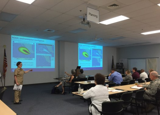 Lt. Cmdr. Meghan McGovern presents NOAA navigation support capabilities to the Federal Emergency Management Agency.